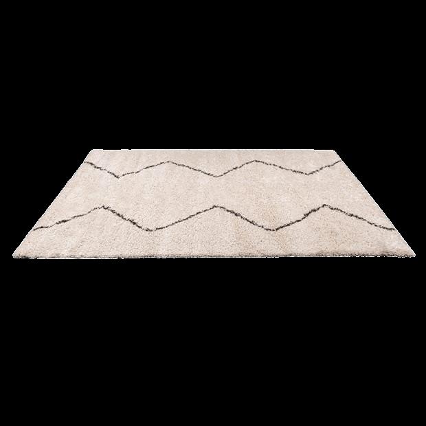 Un tapis oriental beige et noir